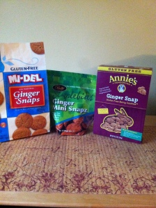 Three brands of gluten free ginger snap cookies: MI-DEL, Pamela's, and Annie's brands.