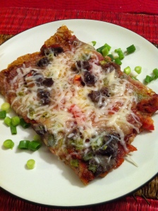 Gluten Free Pizza with ground beef, green onions, pepperoni, fresh tomatoes and mozzarella cheese.